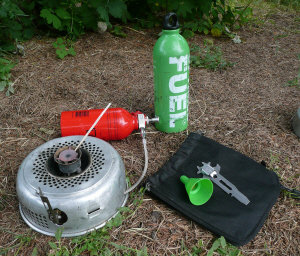 Picture of Gas burner fitted with burner tool & funnel sitting alongside