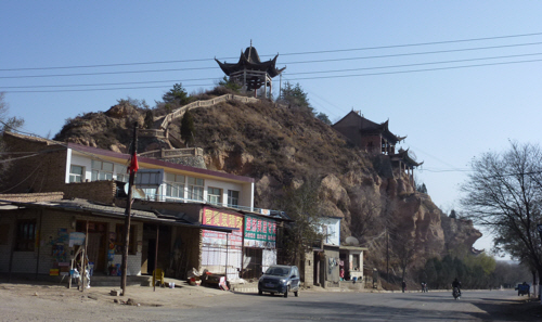 Temples perched over villages along our route