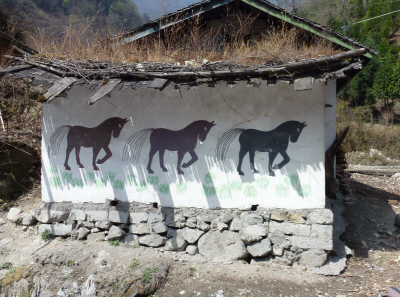 The changing artwork on Sichuan houses.
