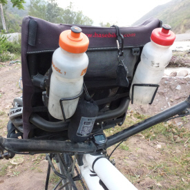 Pilot's speedo at base of handlebars, with seat-cover packaged above & pilot's water bottles
