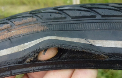 It's the end of the road for this barely-used tyre.  Look at that pristine tread.  Heartbreaking.