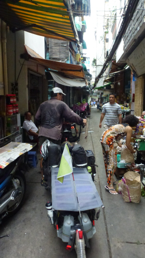 Manfully navigating the Pino through narrow, crowded alleys in Ho Chi Minh City.