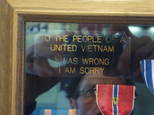 One of the many moving exhibits at the War Remnants Museum.  An American vet presented his war medals to the museum, mounted with an inscription reading: To the people of united Vietnam, I was wrong, I am sorry.