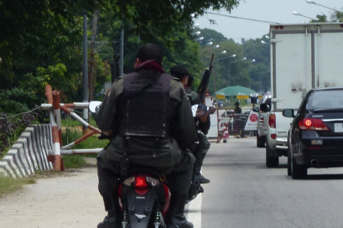 Armed personnel approaching a checkpoint in Narathiwat province.