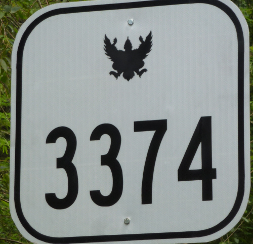 Squashed sparrows on the road signs.  Doesn't this bird motif just look like roadkill?