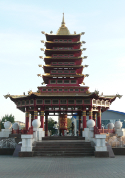 Prayer wheel and pagoda.