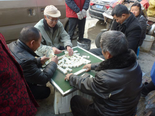 Mahjong being played by the locals on the pavement near the meat-market
