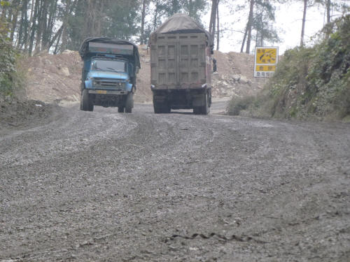 8% gradient, mud & trucks on the main road into Guiyang