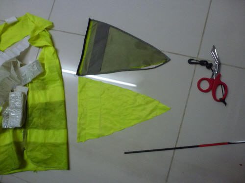 A discarded hi viz jacket found on the roadside being re-purposed into a new flag for our trailer.
